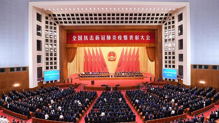 Xi praises COVID role models in speech